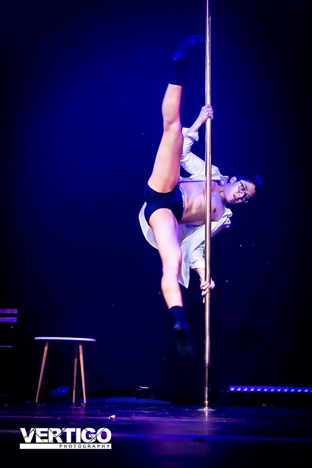 image of man performing on stage, pole dancing, pole dancing classes, pole dancing classes melbourne, pole fitness